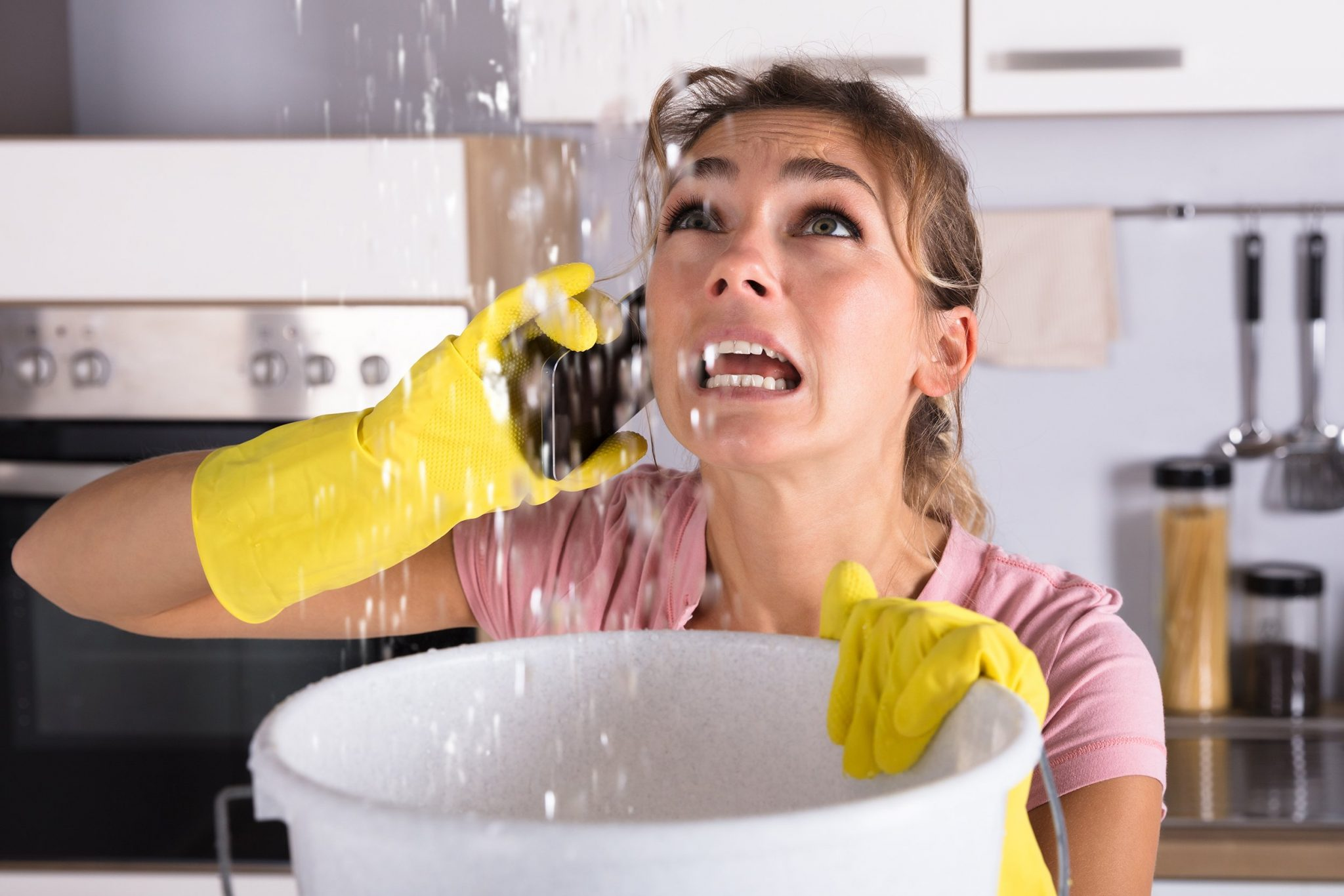 A woman calling a plumber | Water Heater Replacement | Gainesville, FL